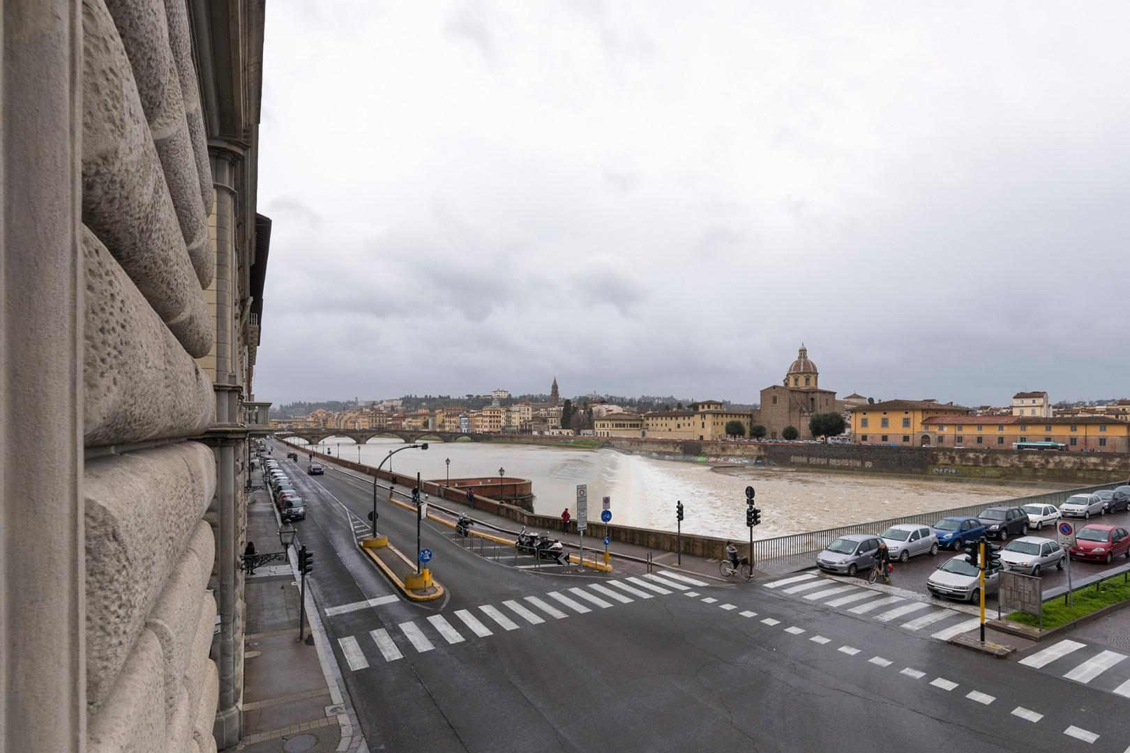Enjoy views of the Arno river and the hills beyond that rise above the Oltrarno area of Florence.