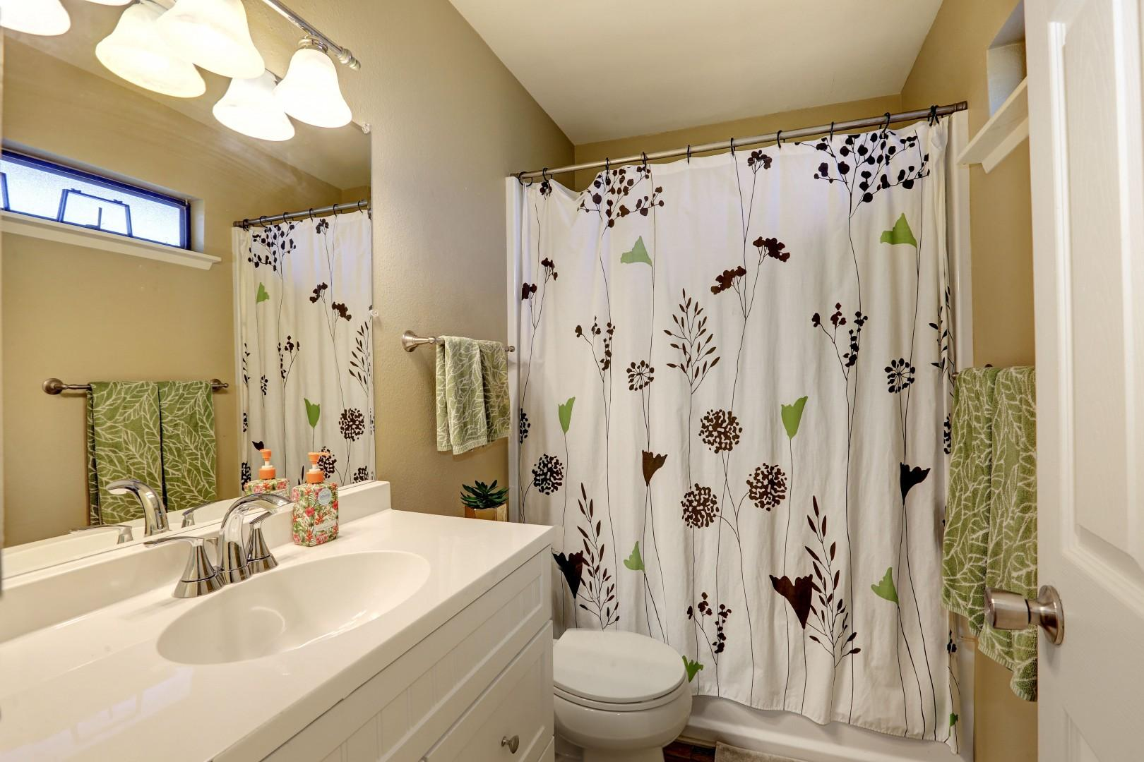 Light and bright bathroom with shower tub-min