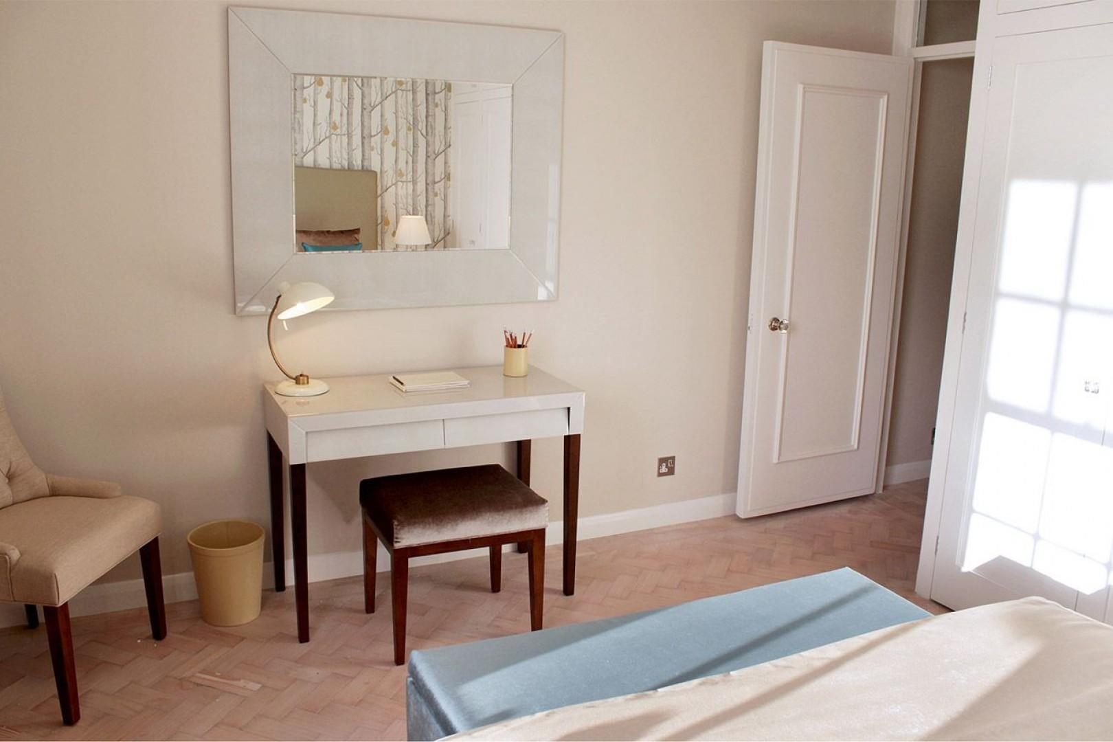 Writing desk and armchair in Notting Hill bedroom