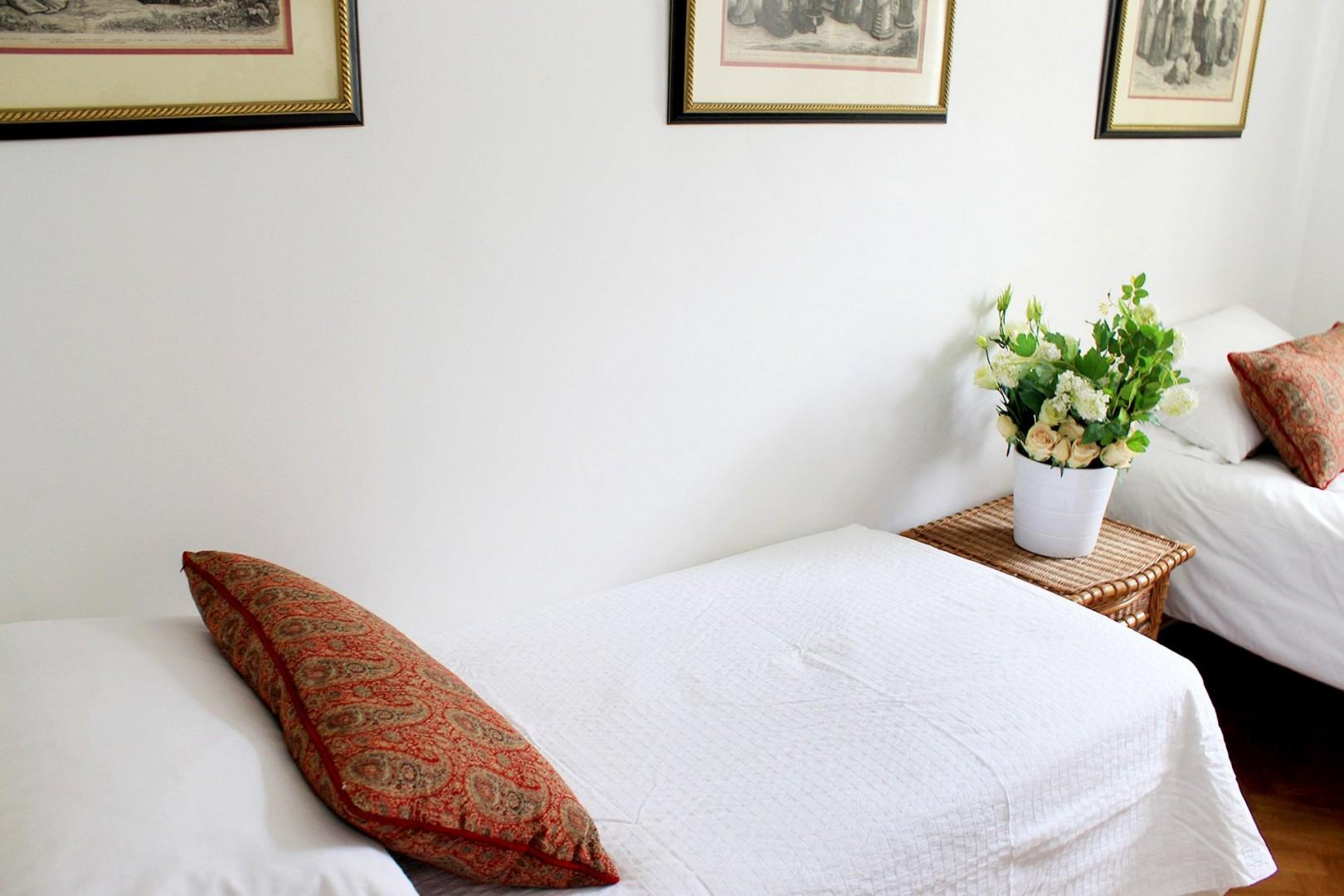 Two beds with high-quality mattresses and linens