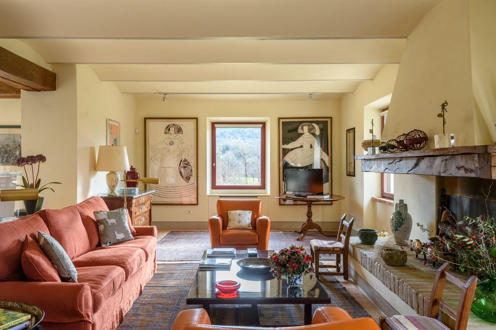 Elegant living room has marvelous views to the outdoors and a bevy of comfortable seating.