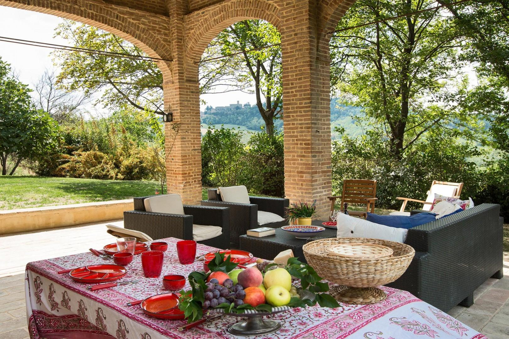 The delightful covered terrace offers a view all the way to the nearby castle.