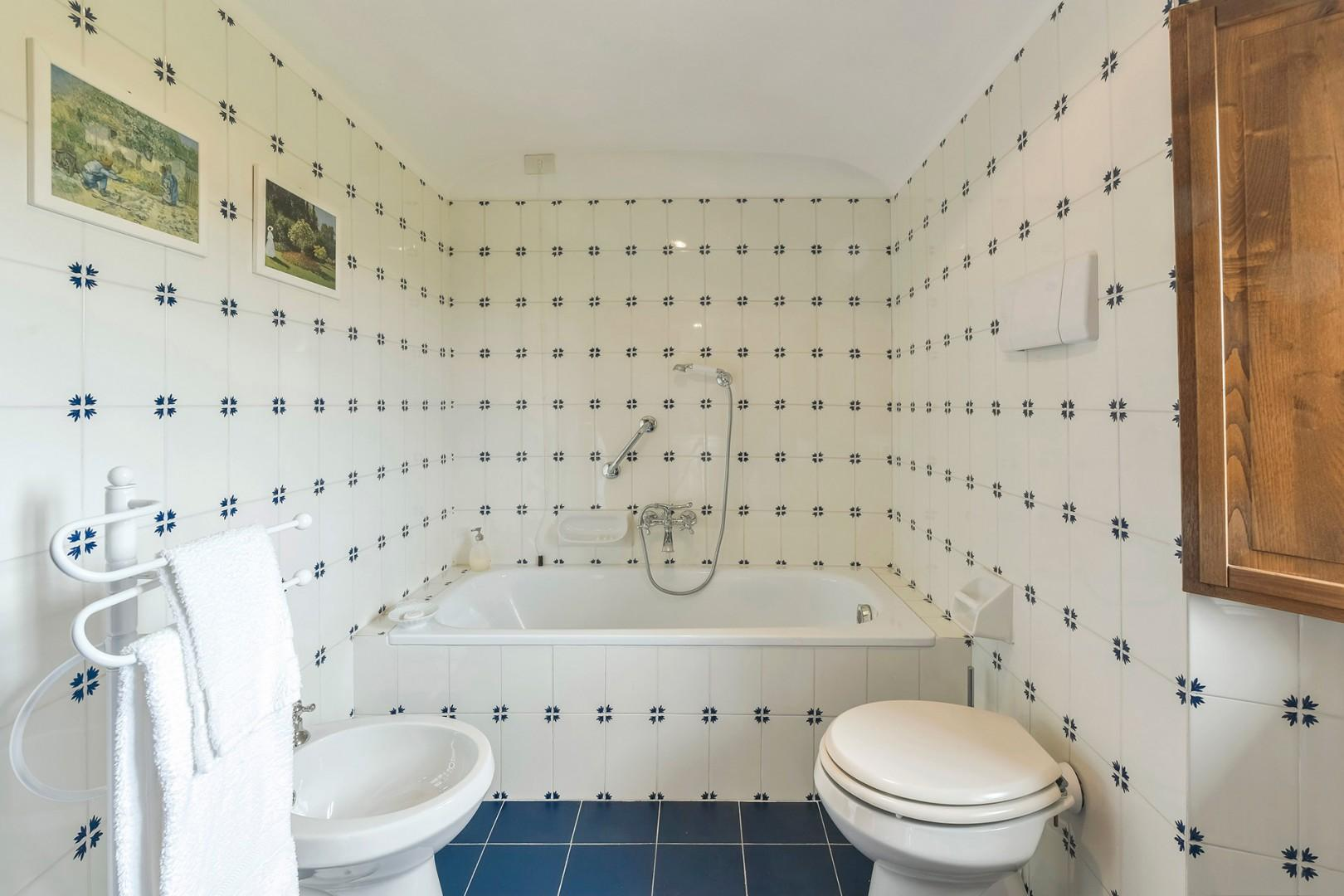 Bathroom 3 has a tub with handheld showerhead.
