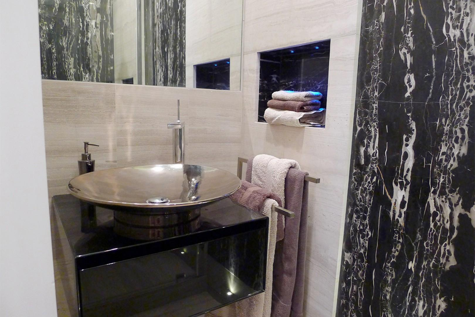 Enjoy the high-end finishes and a rainfall showerhead in bathroom 2.