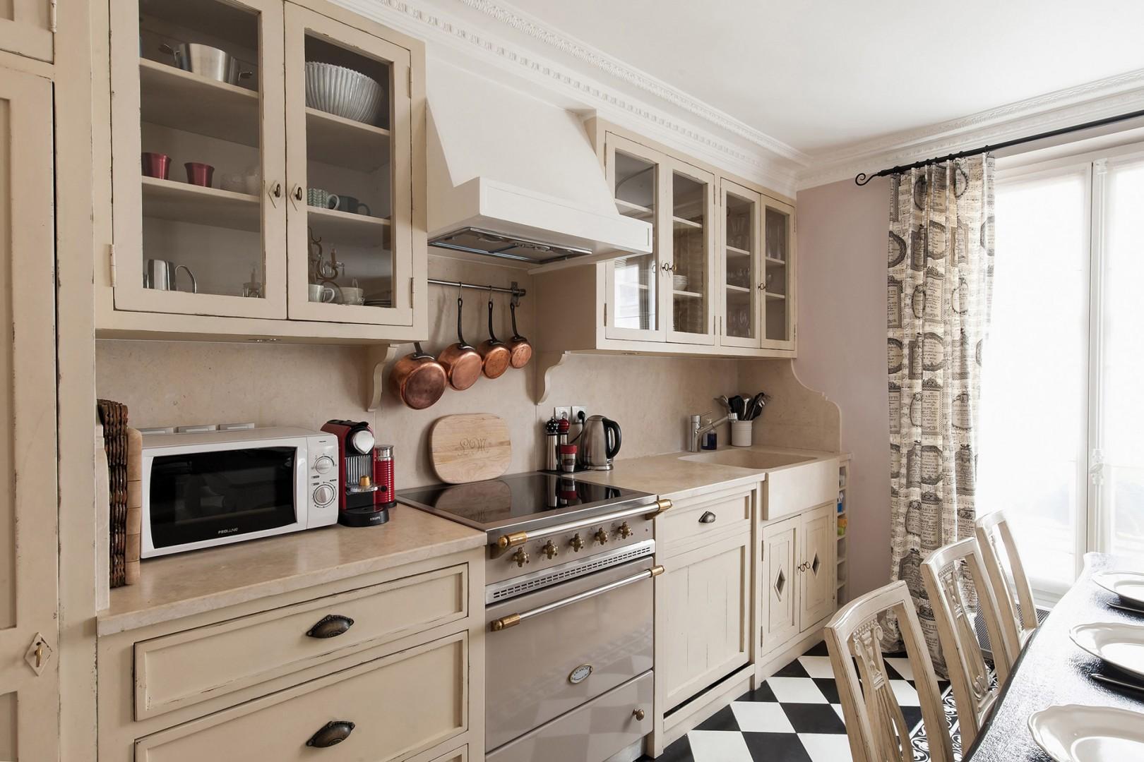 Sunlight streams into the beautiful Parisian kitchen.