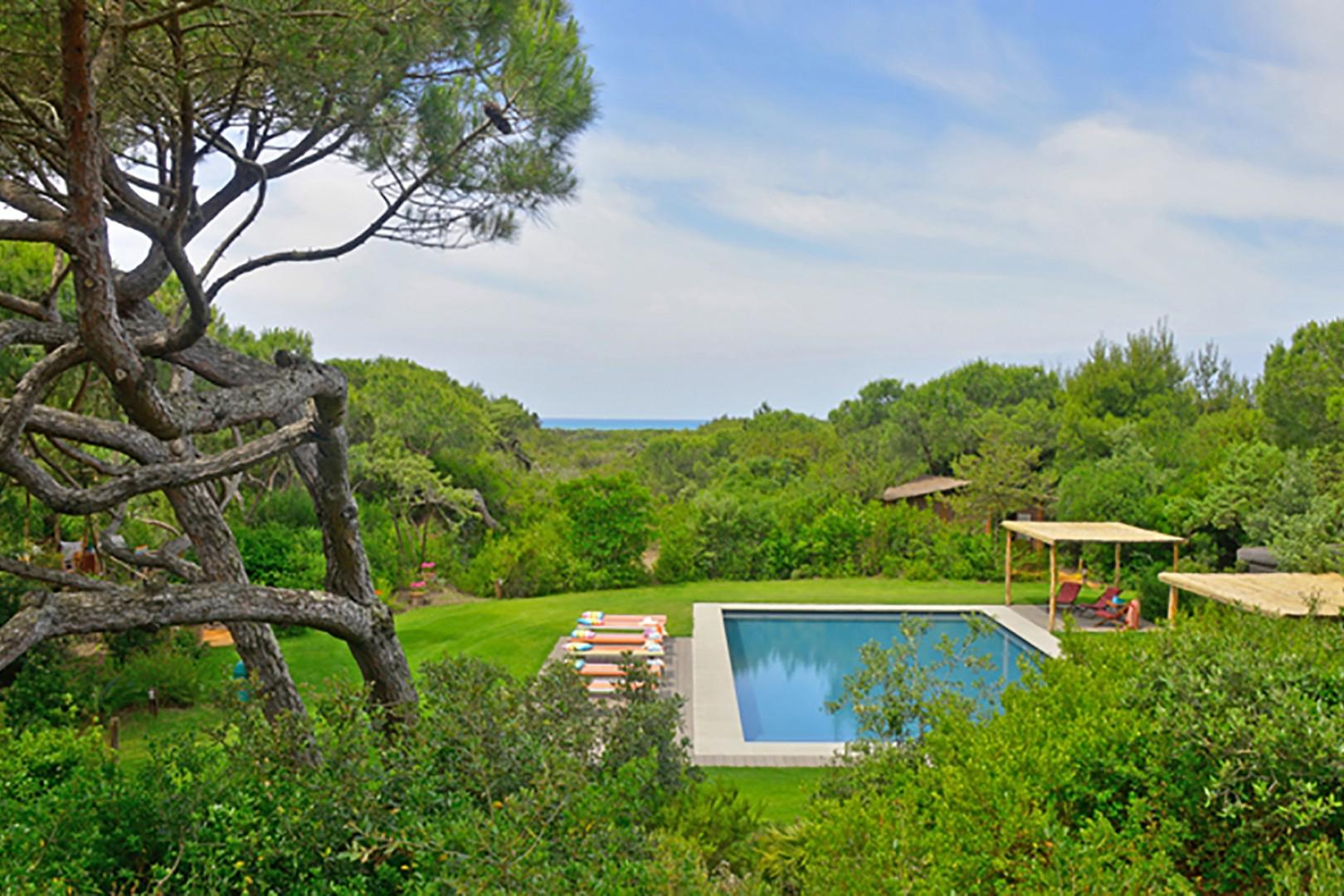 Sparkling swimming pool with the gorgeous blue Mediterranean sea in the backdrop.