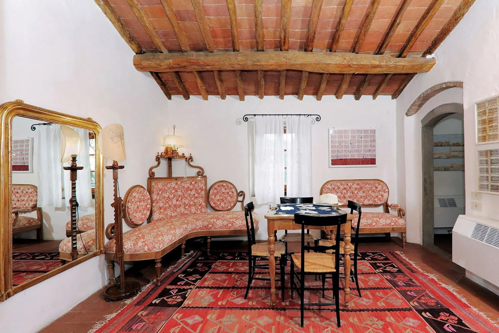 Sitting room with card table outside bedroom 2.