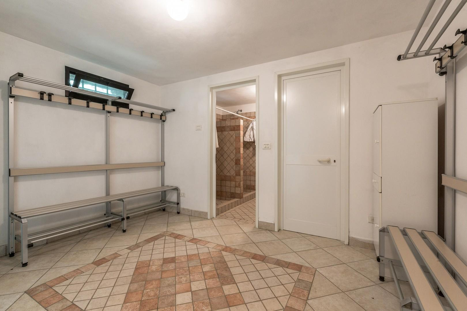 Changing room and full bathroom in the pool house below the pool.