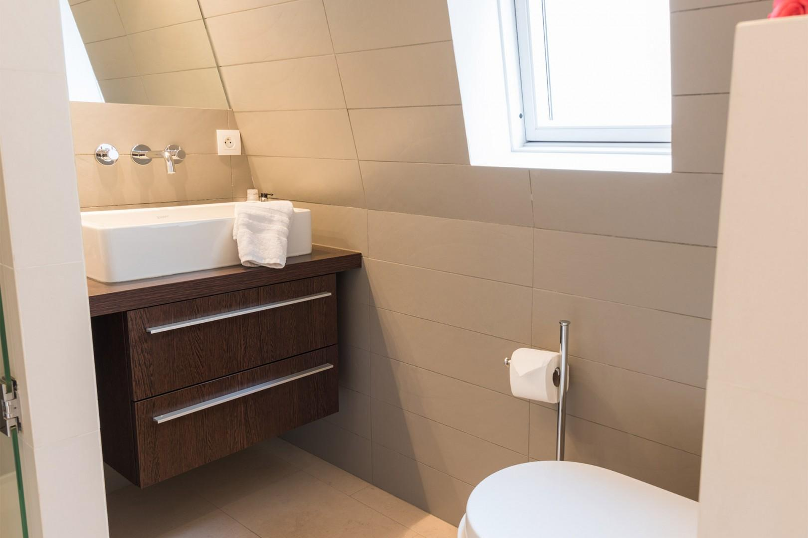 Enjoy modern amenities and finishes in the bathroom.
