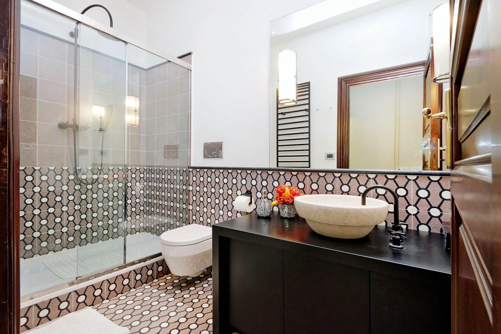 Clean, modern, bathroom 1...great tiles!