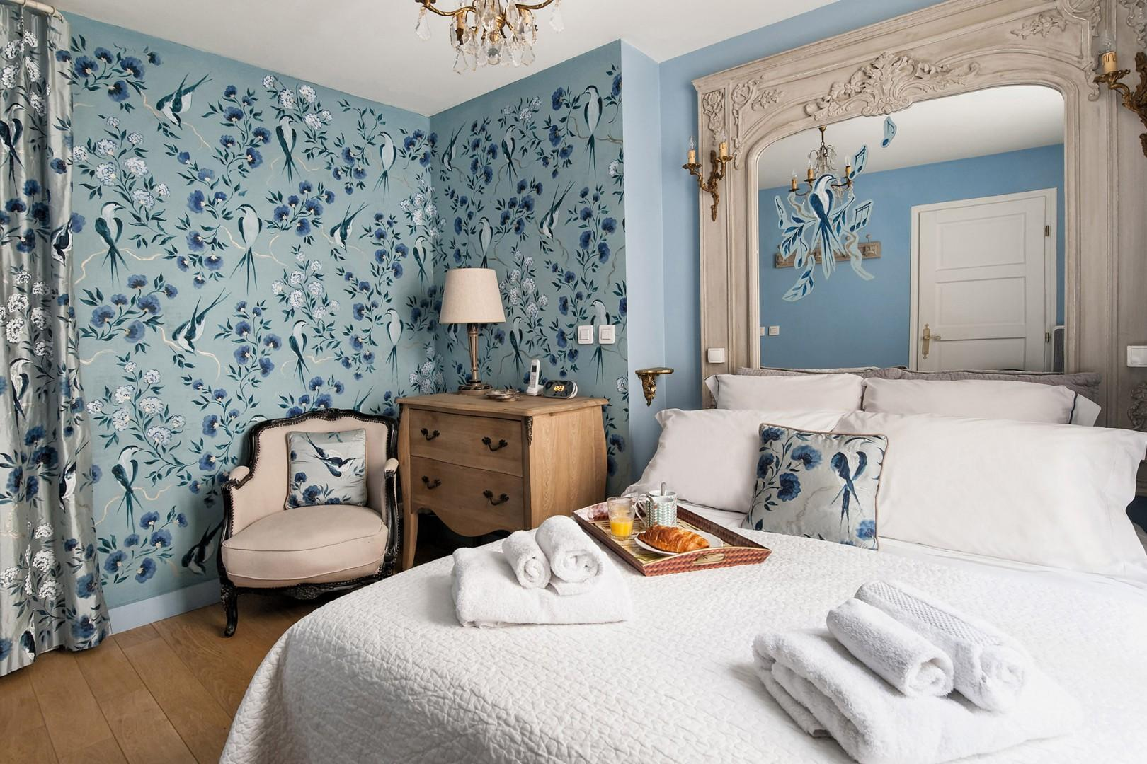 Feel at home in the gorgeous bedroom 2 with a comfortable bed and stylish décor.