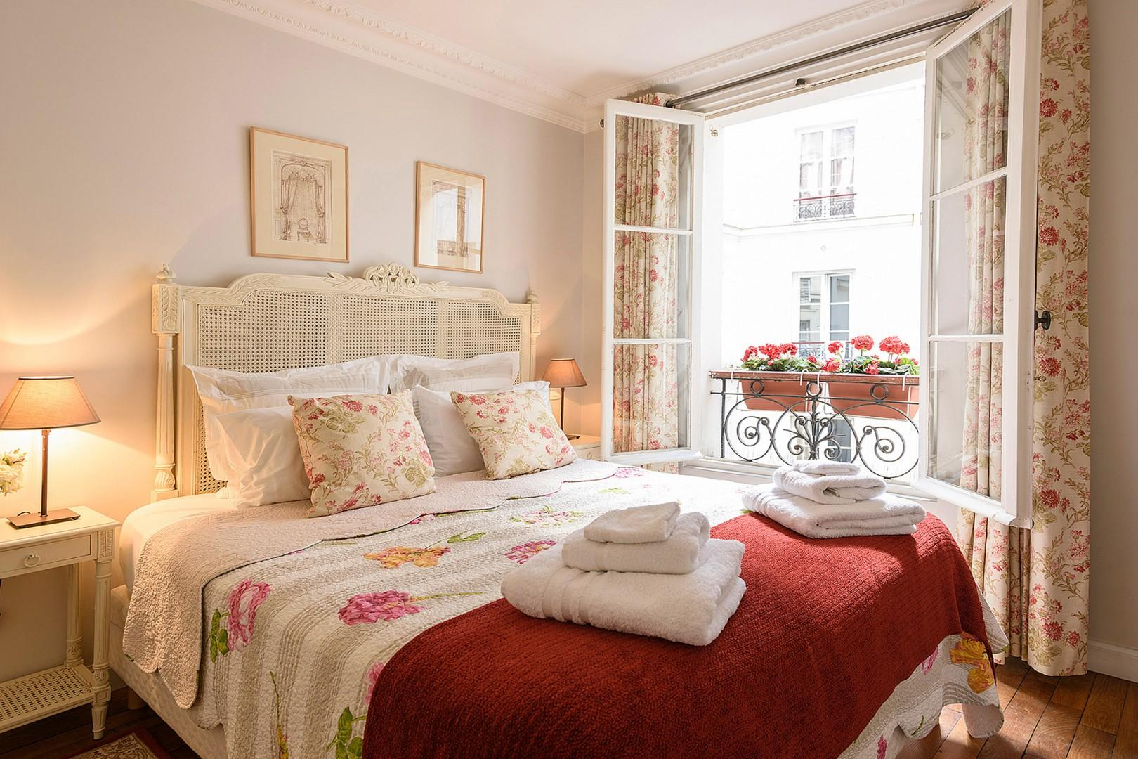 Relax in the lovely French bedroom with a comfortable bed.