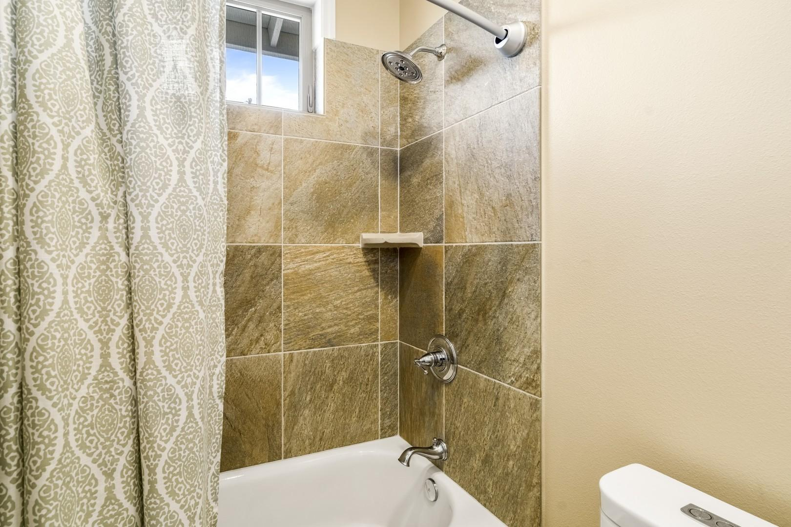 Tub / shower combo in the upstairs guest bathroom