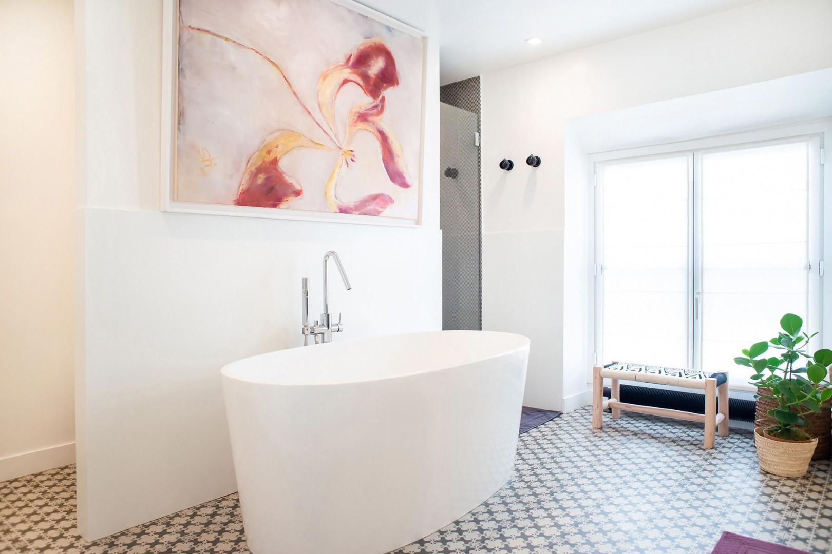 Bathroom 2 has a modern bath perfect for a long soak