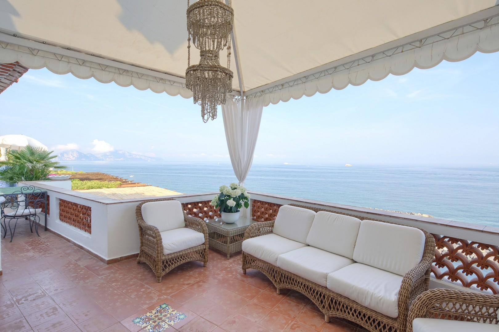 Relax to the sounds of the sea and views across to the legendary Isle of Capri.