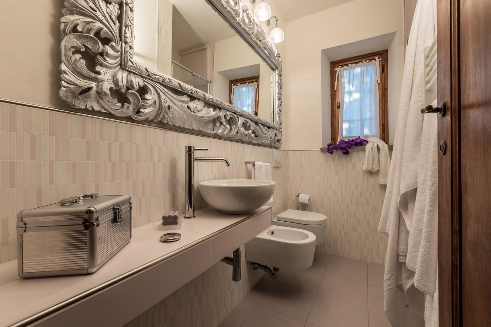 En suite bathroom to bedroom 1