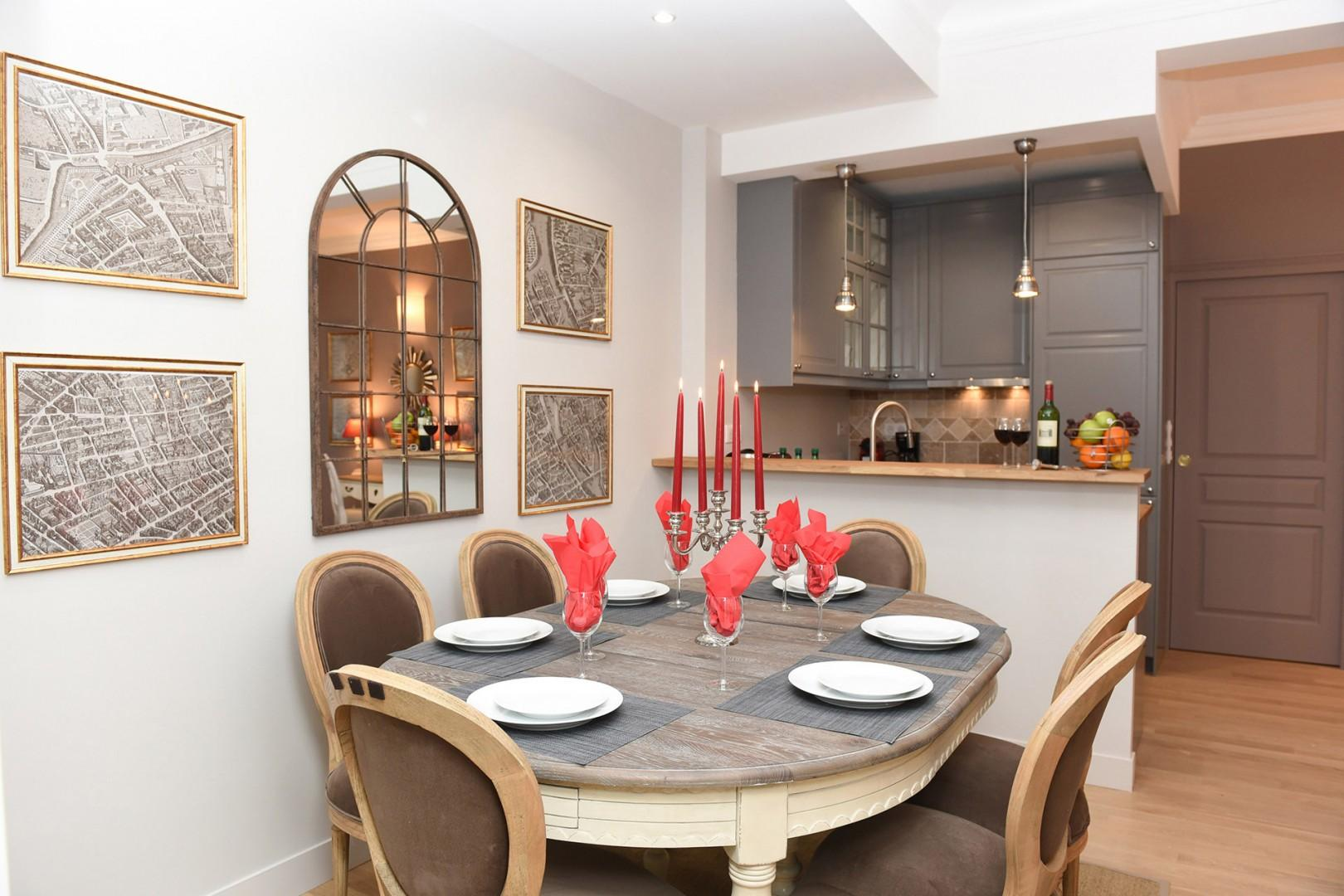 The dining table comfortably seats up to six people.