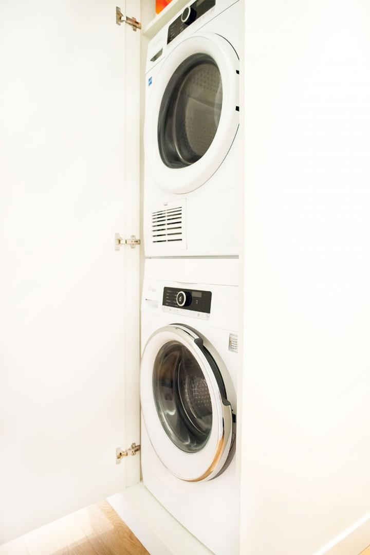 Separate washing machine and dryer in the hallway