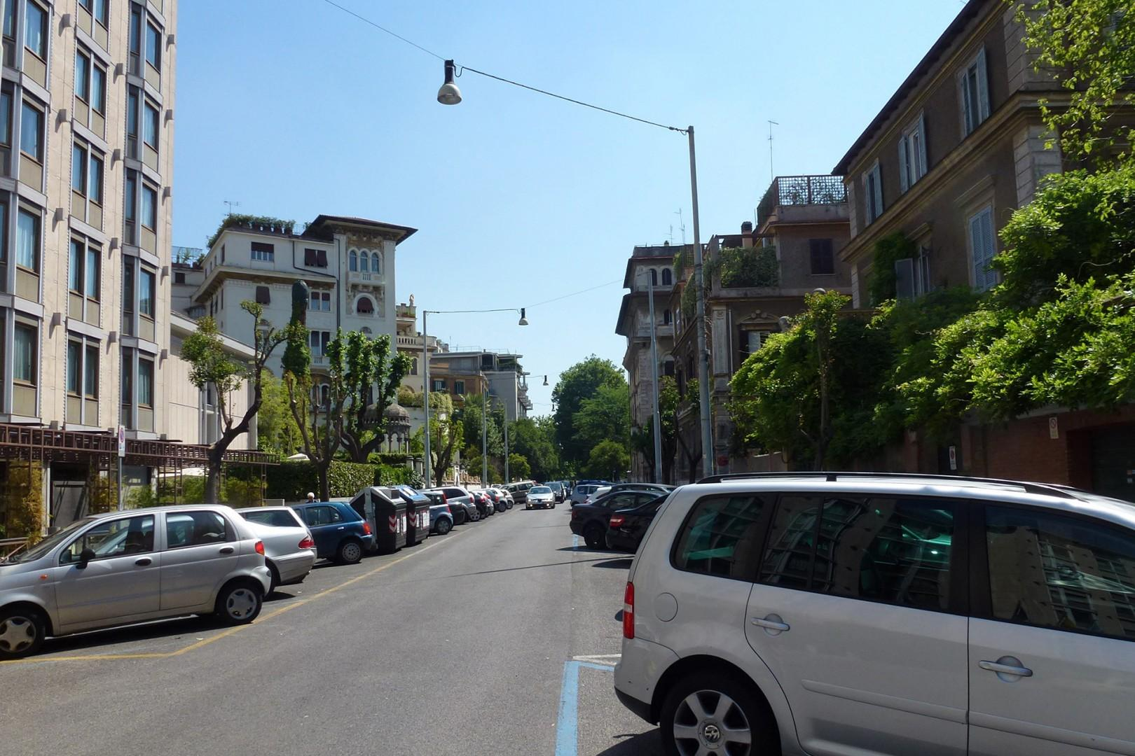 Tree lined street on which the apartment is located is characteristic of the Prati area of Rome.