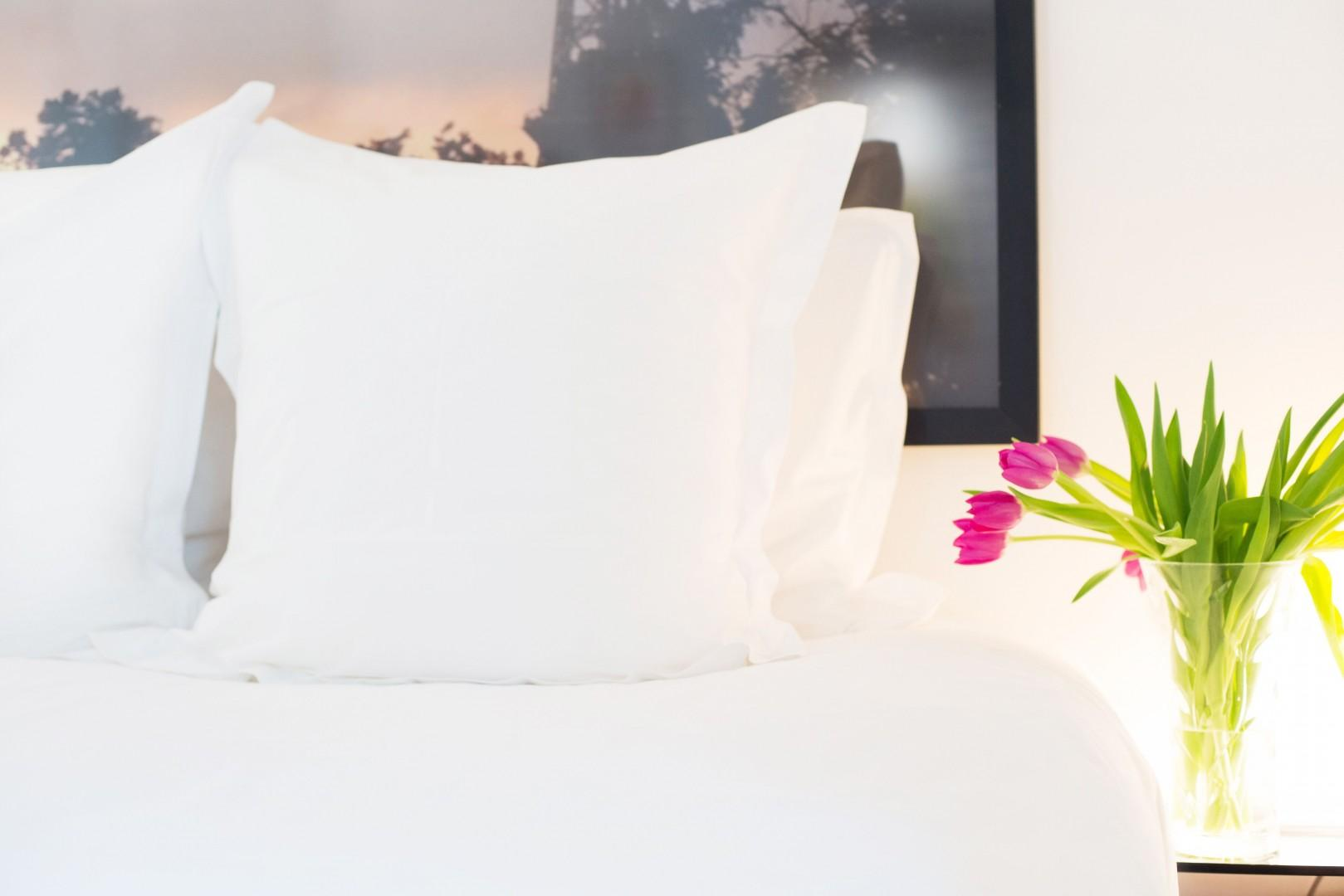 Decorate your bedroom with fresh flowers from local florists.