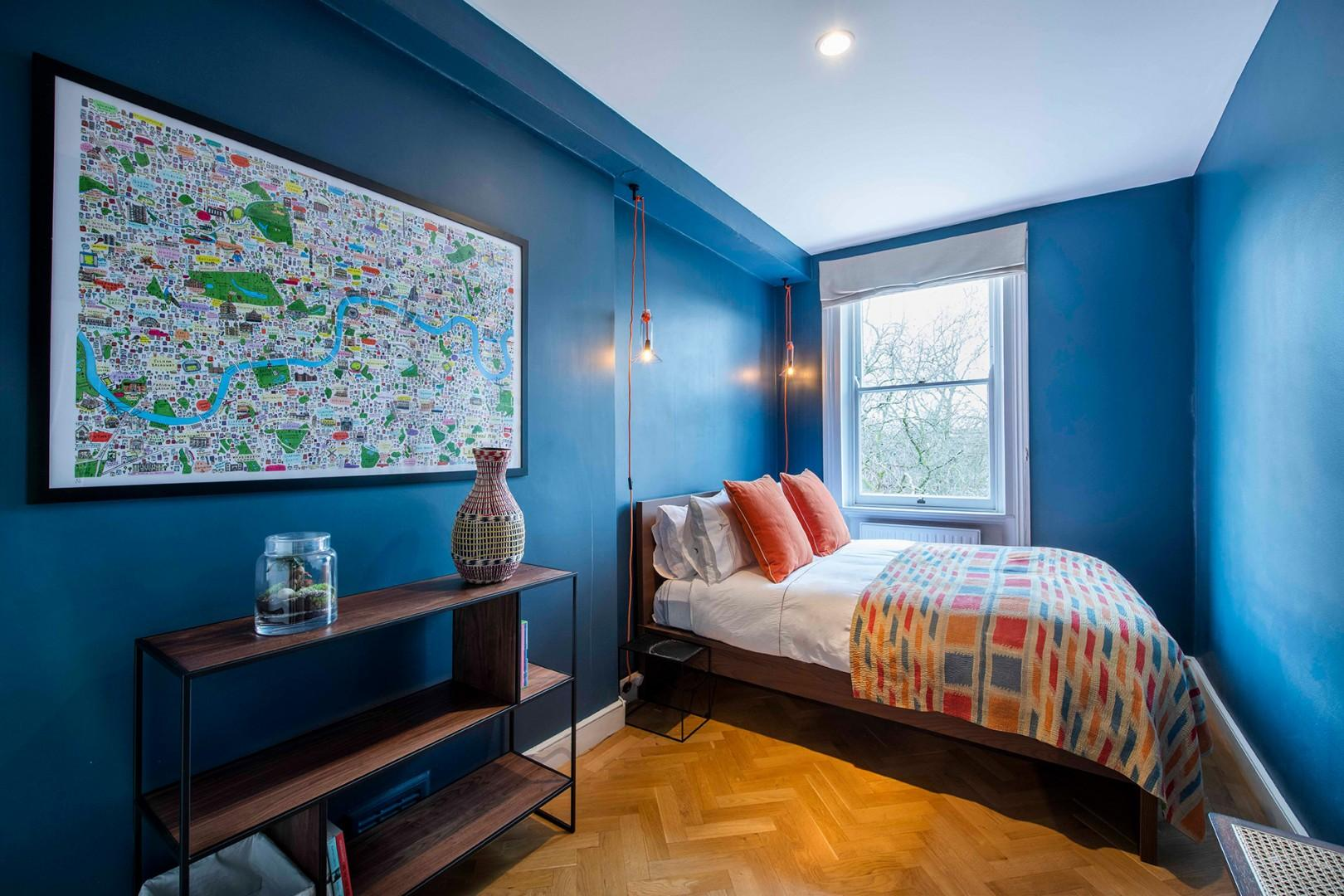 Bedroom 2 is a tranquil retreat in a soothing azure shade