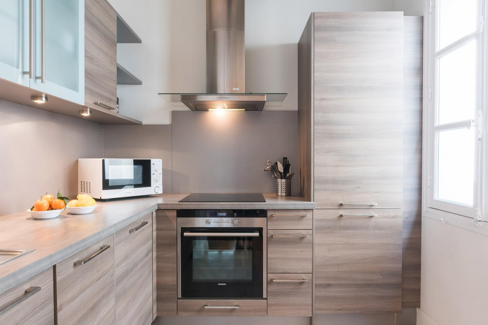 The modern kitchen equipped with everything you need to cook at home.