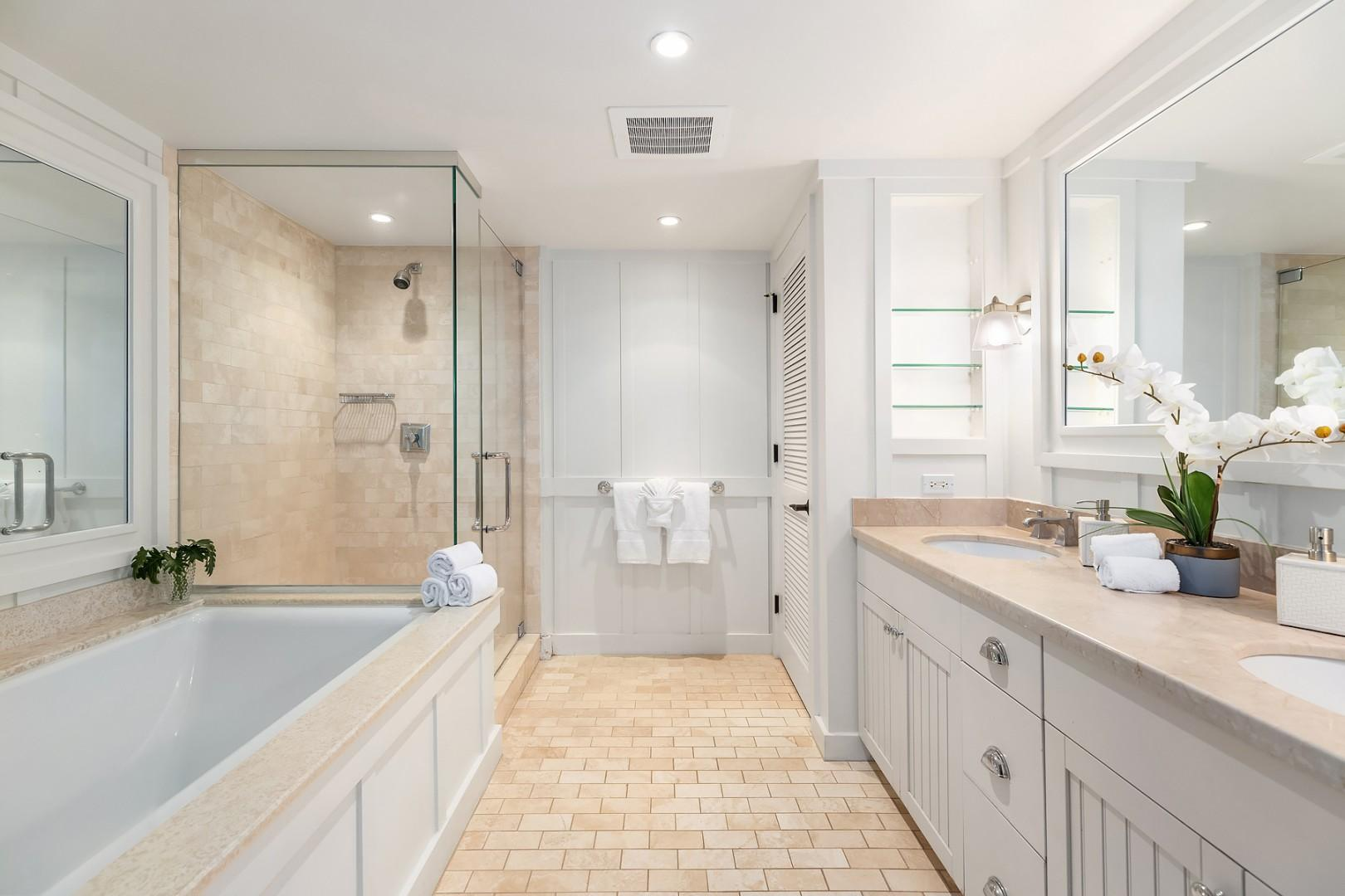 Beautiful master ensuite with dual sinks, soaking tub, and separate shower stall.