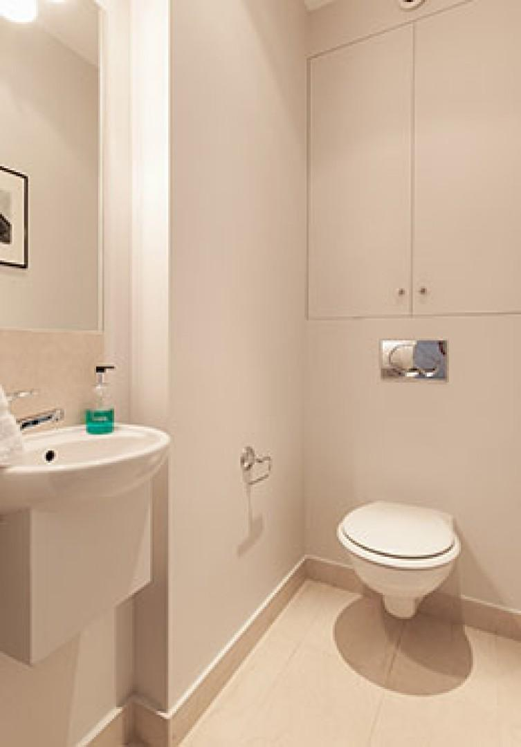 There is also a convenient half bath with a toilet and sink.
