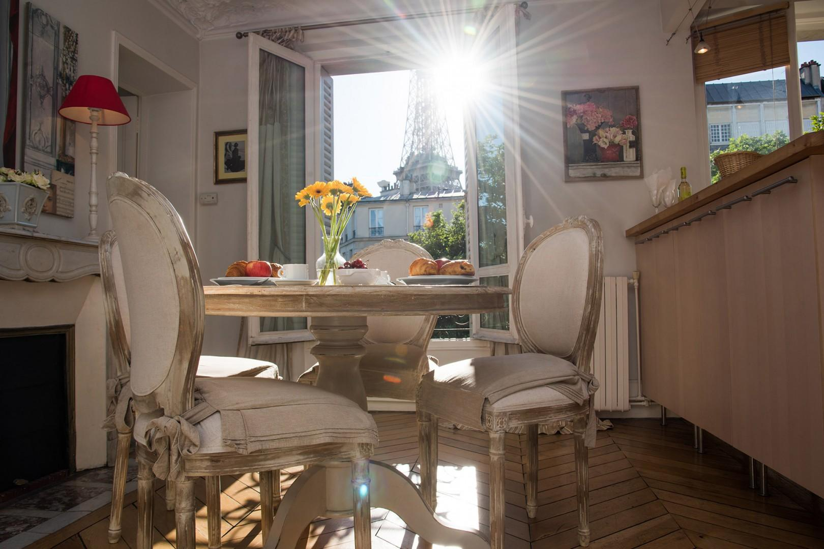 Sunlight streams into the cozy dining room.