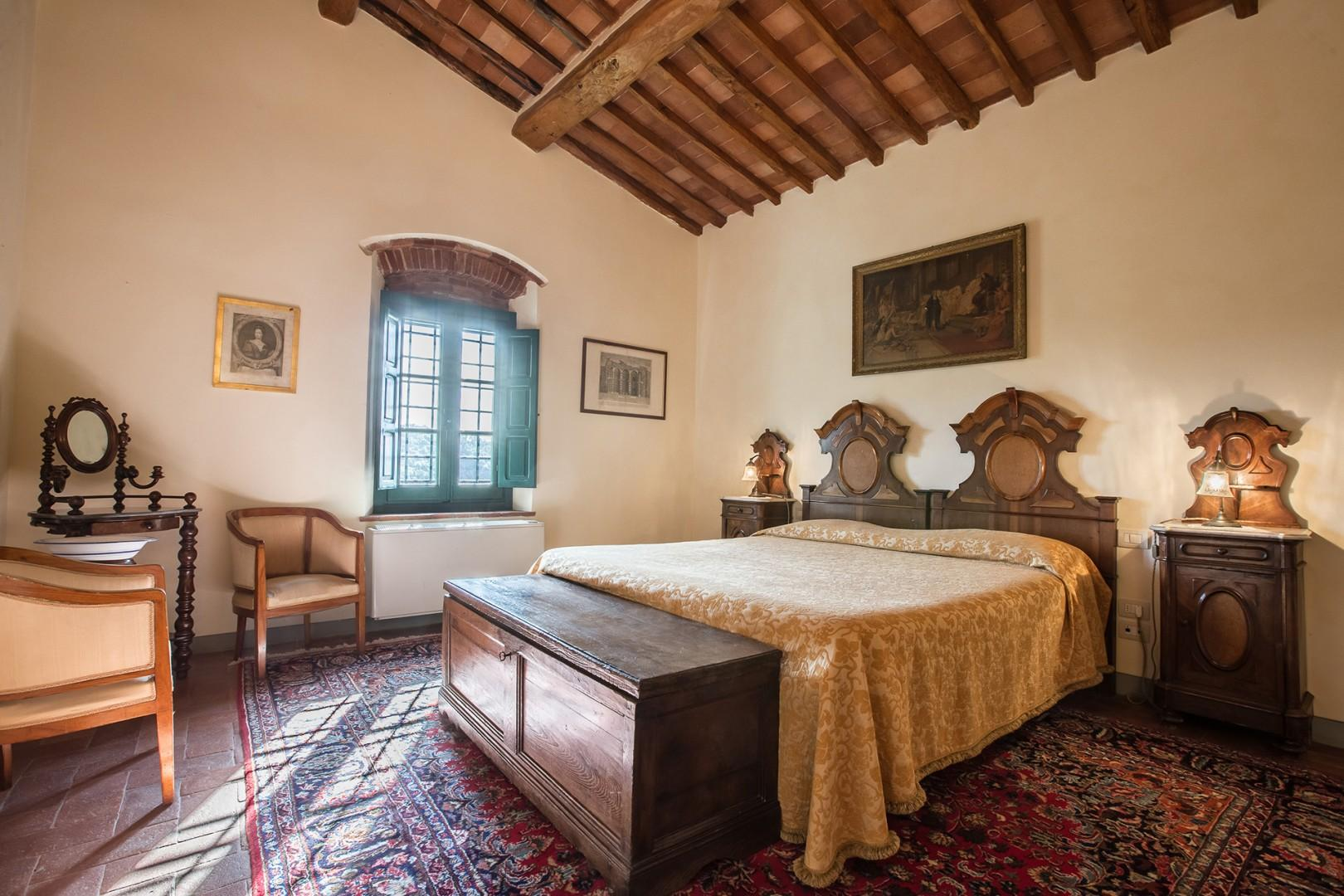 Bedroom 1 features a comfortable bed with intriguing Louis Philippe Tuscan headboards.
