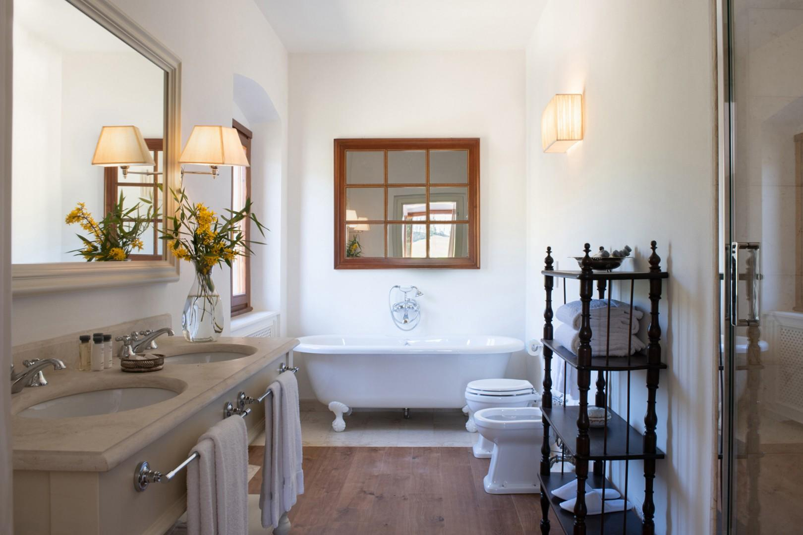 Ground floor bathroom has charming tub as well as step in shower.