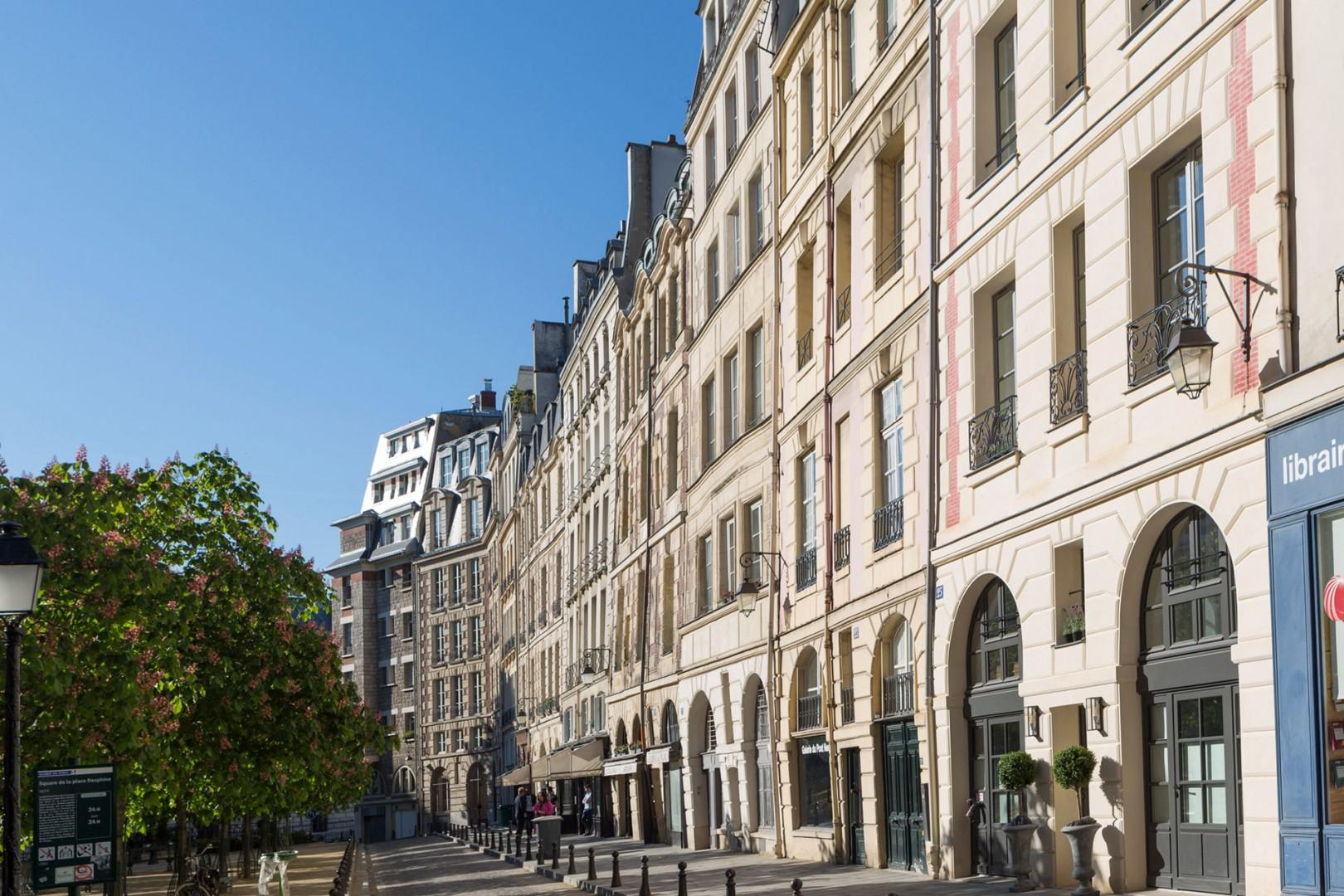 Step outside right on Place Dauphine, lined with historic buildings.