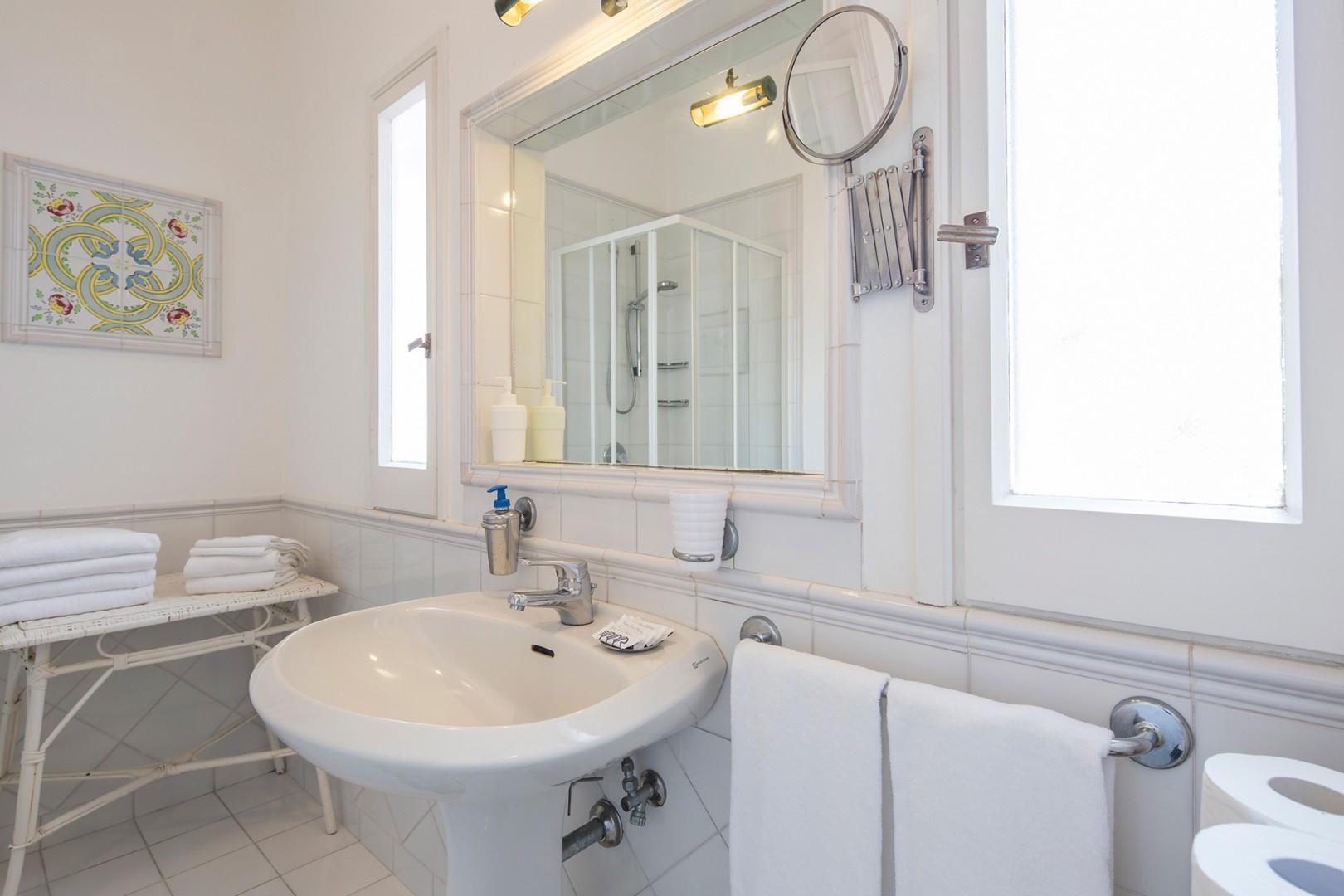 En suite bathroom to bedroom 1 has a shower and sea view.