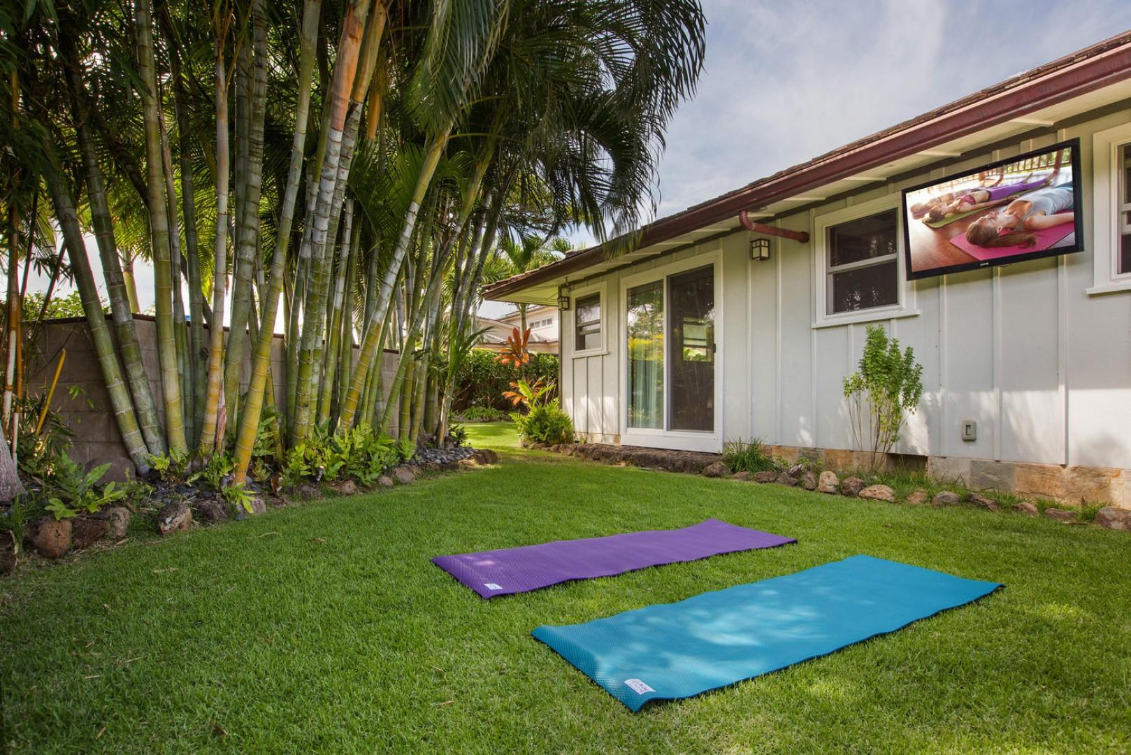 Outside the first-floor master bedroom, facing the queen bedroom with surf bedding, take a meditation break on the lawn, complete with a television for guided yoga.