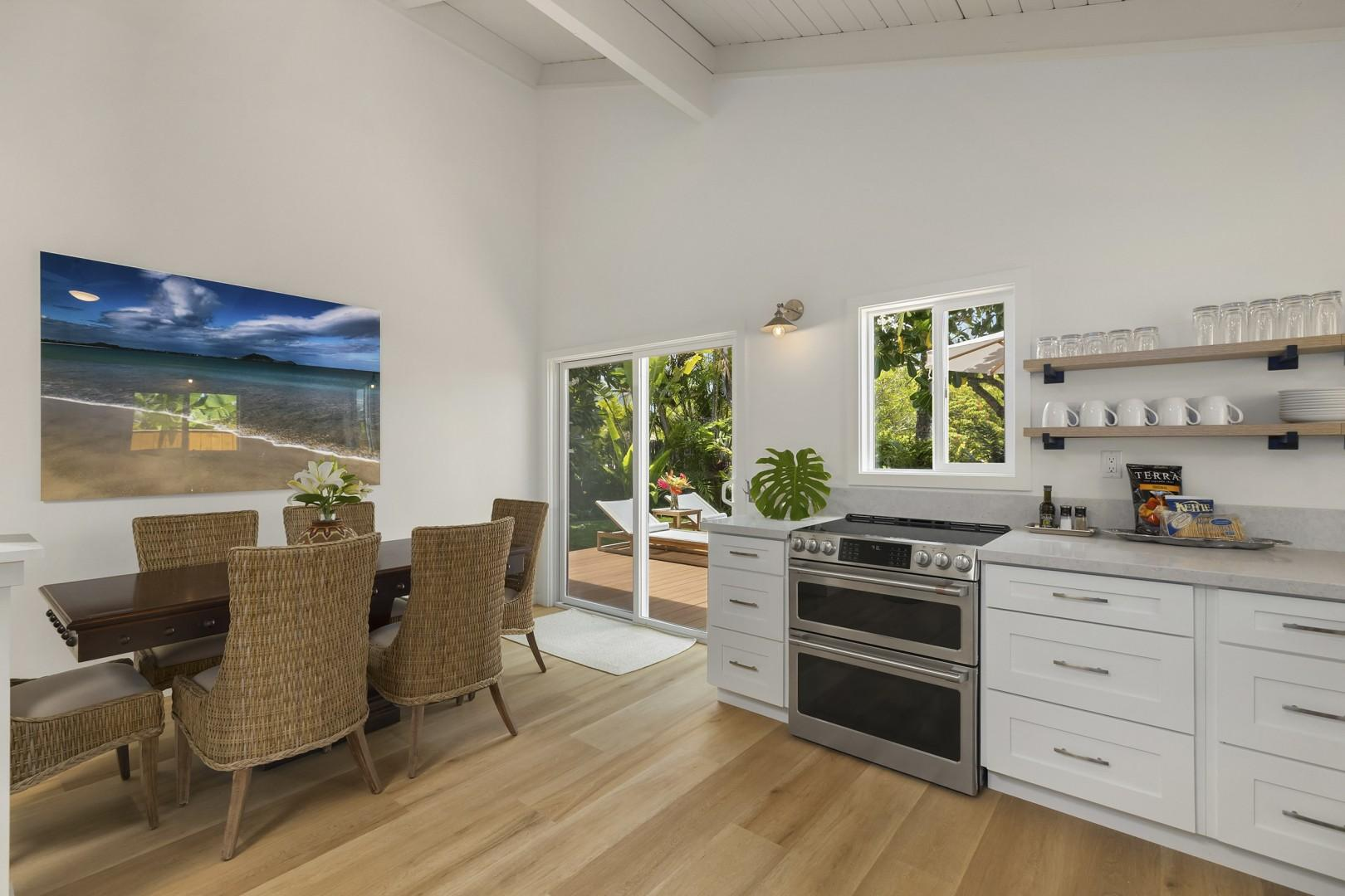 Dining Room with natural lighting and opens to main lanai and garden area.