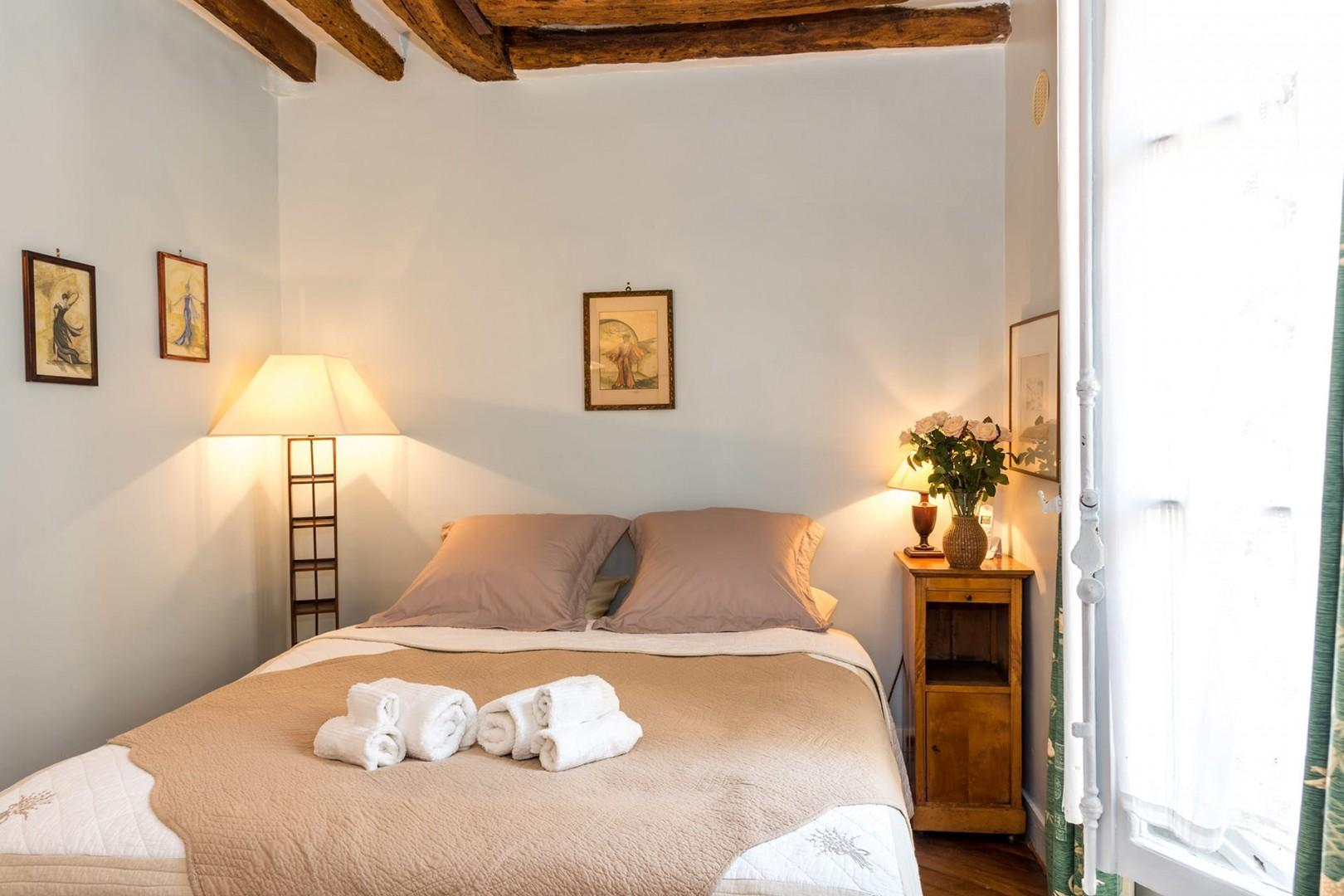 Make yourself at home in the lovely bedroom with a comfortable bed and linens.