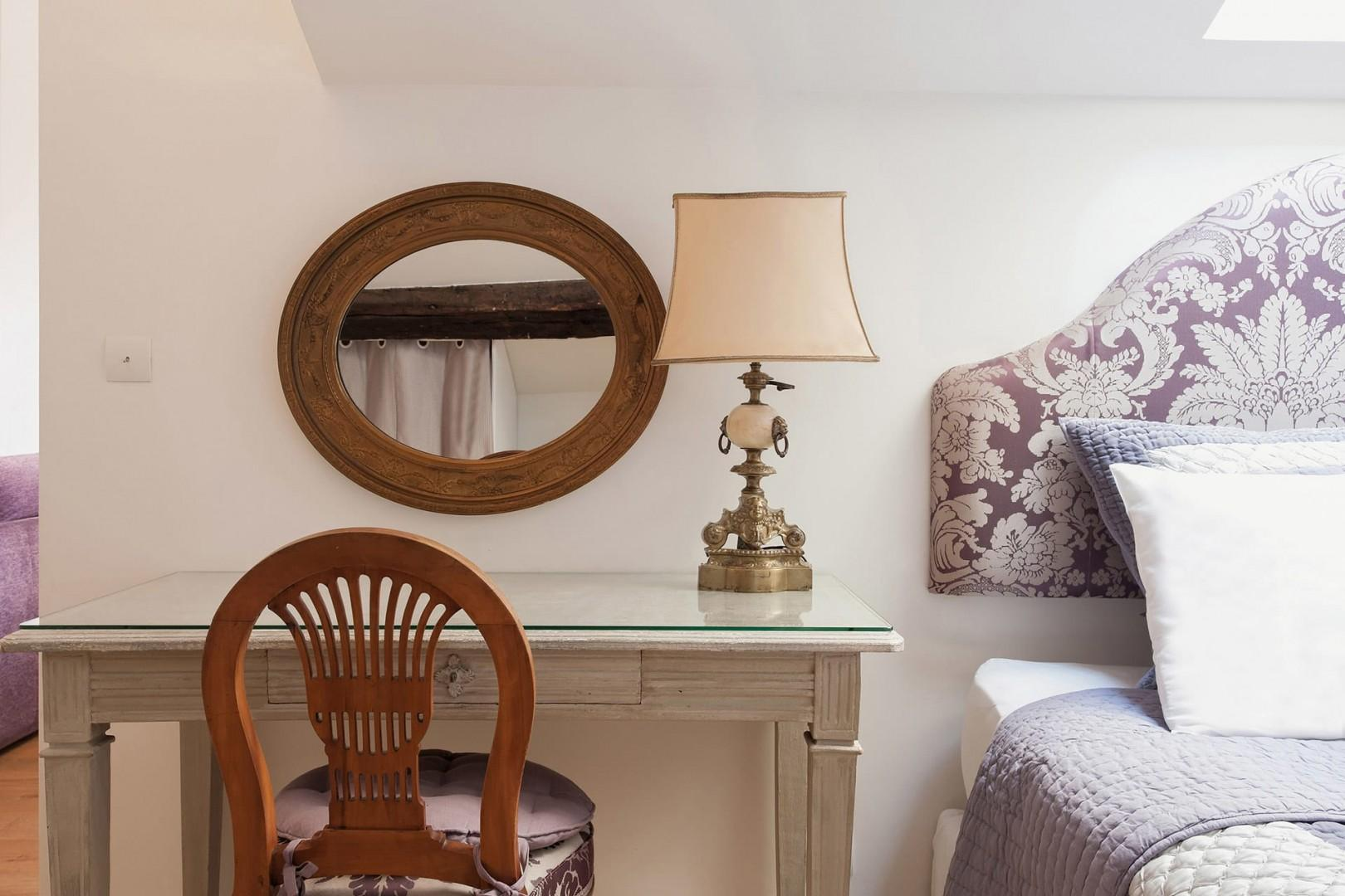 Hand-crafted lamps on the antique French bedroom dresser
