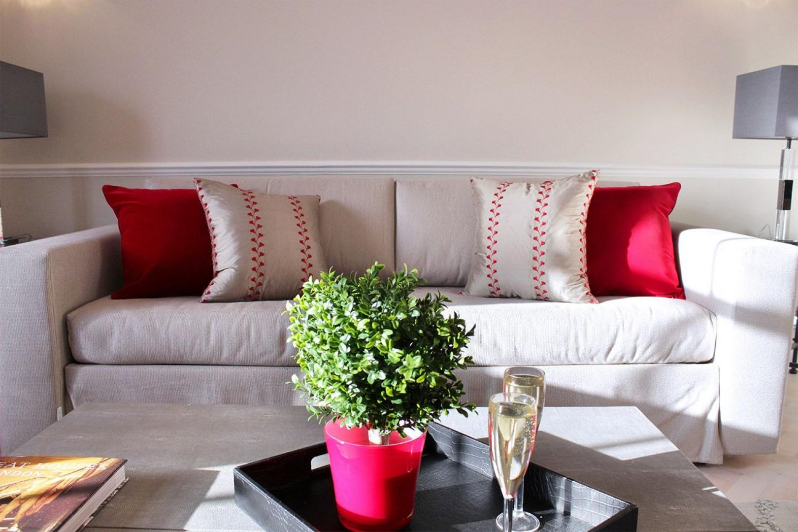 Comfortable sofa in living room converts into two beds