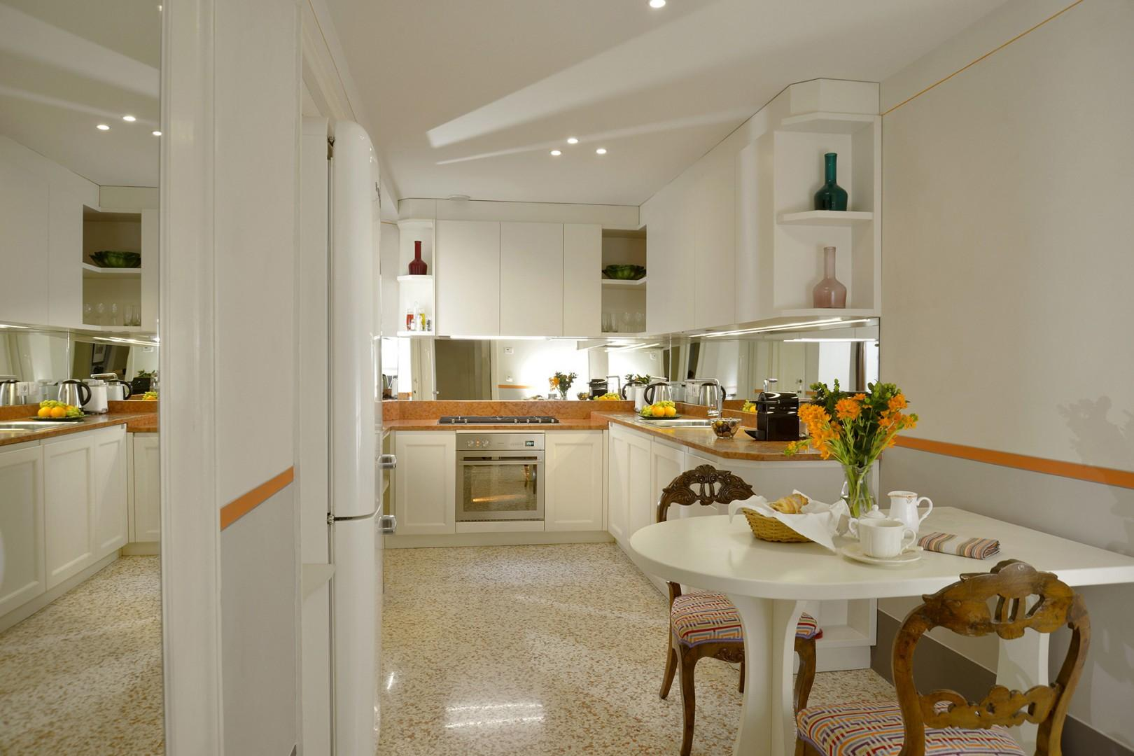 Full kitchen with breakfast table.