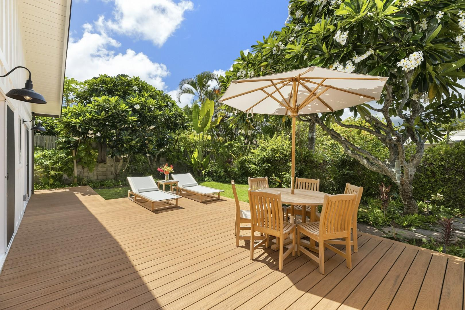 Private, Calm, and peaceful main lanai and garden area. Large deck with Chaise loungers for soaking up the sun and outdoor seating area.