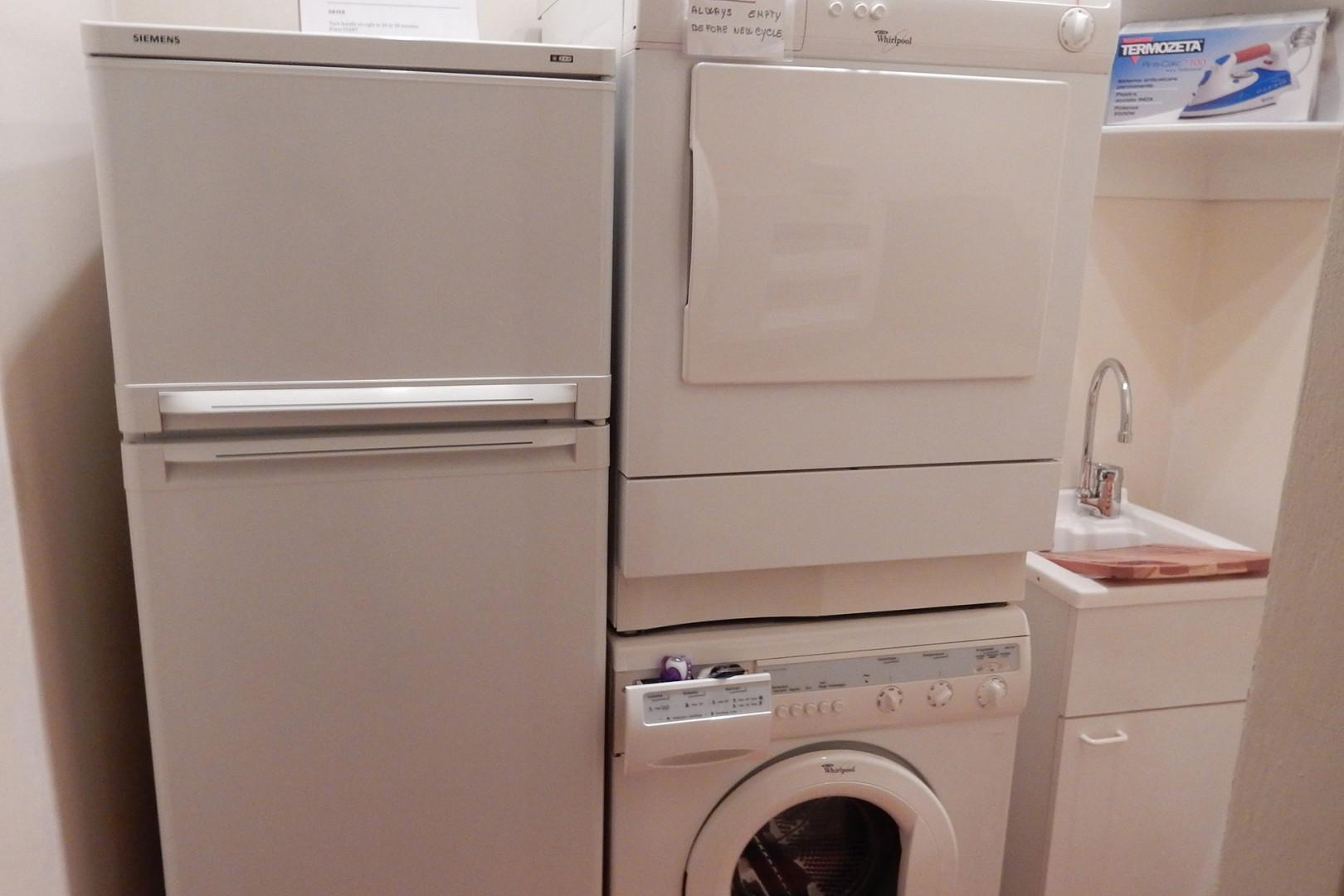 Refrigerator, washer and dryer in apartment.