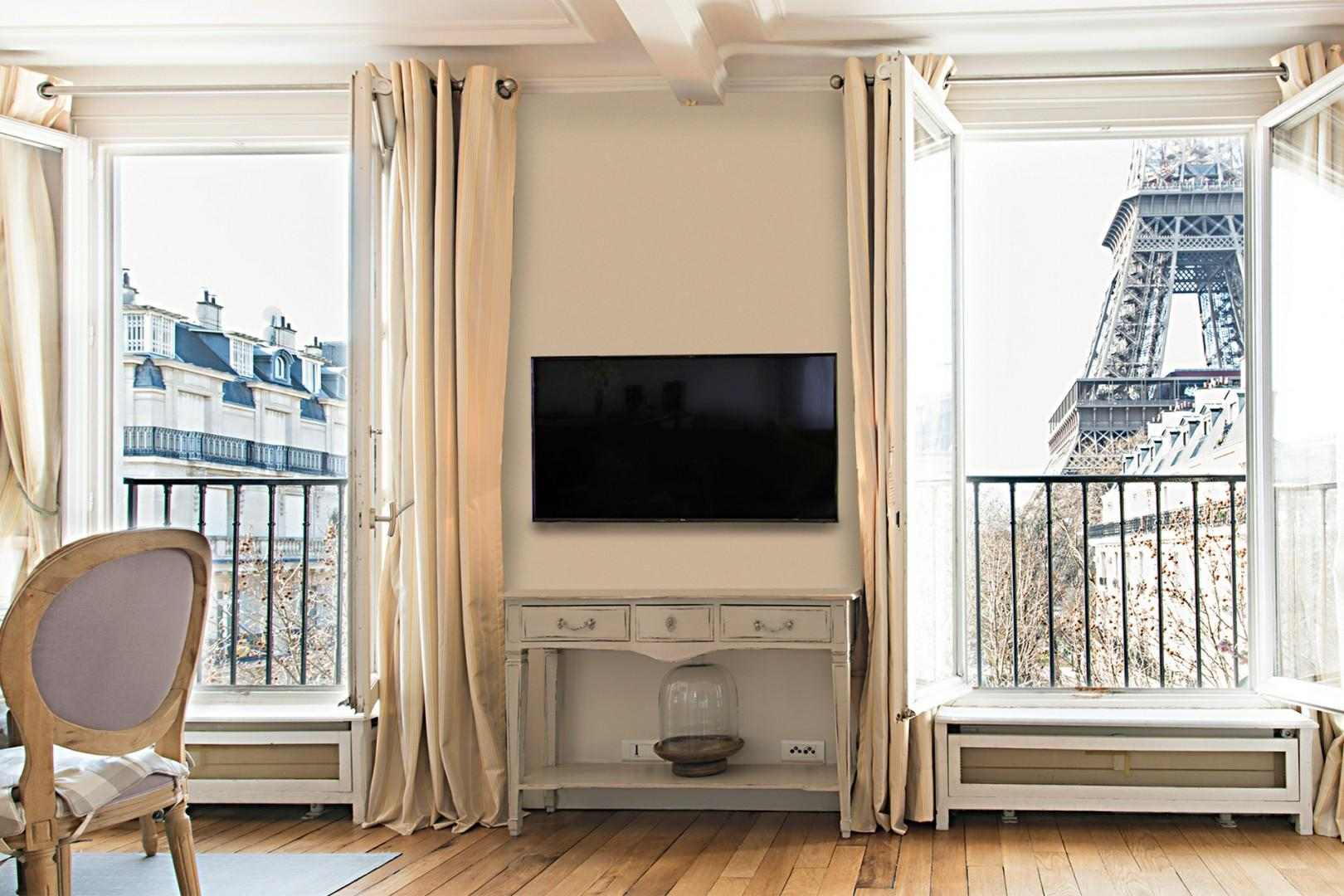 Large windows offer one-of-a-kind Eiffel Tower views.