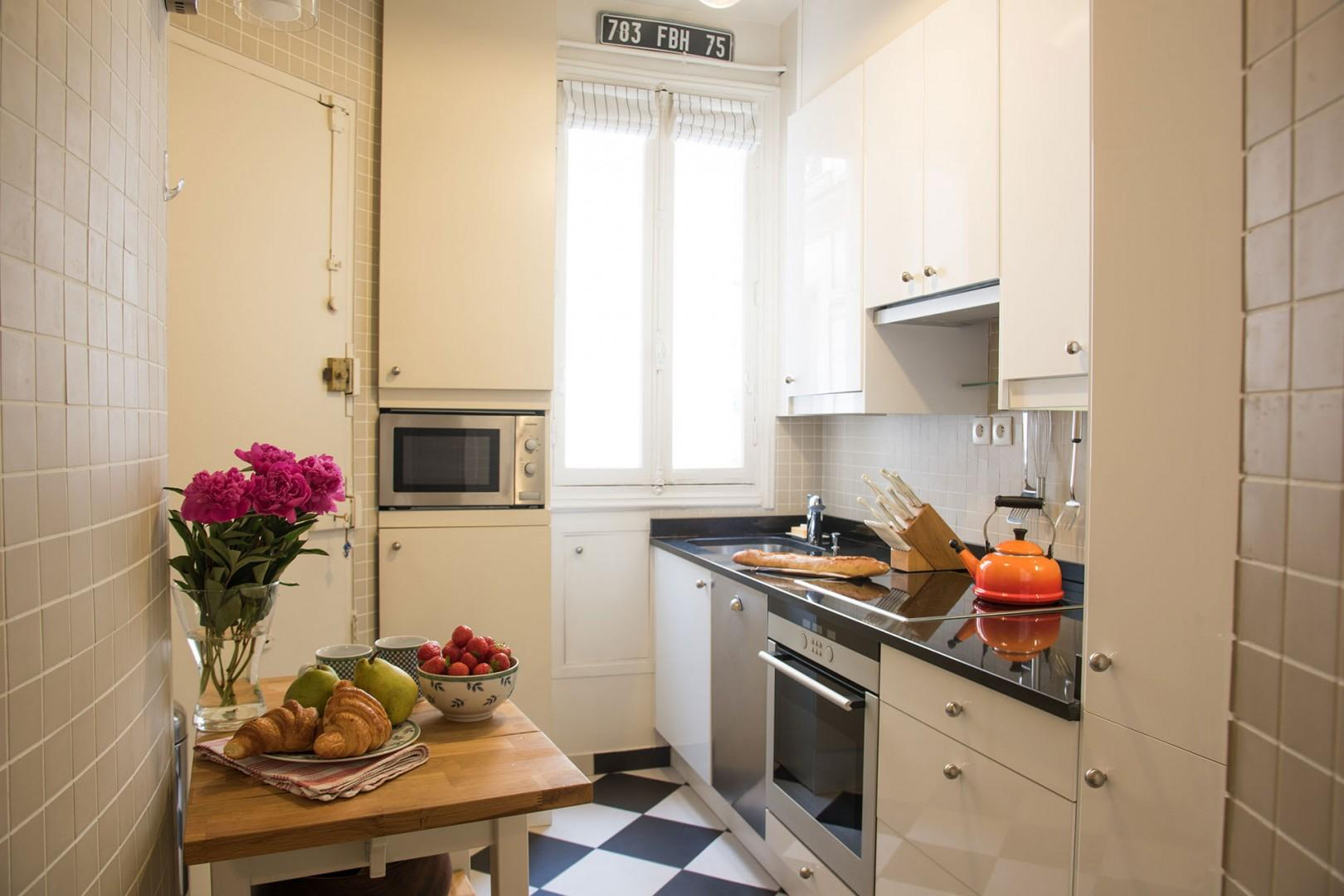 The fully equipped kitchen comes with modern appliances.