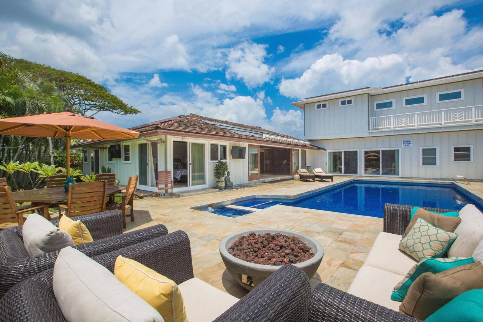 The luxurious saltwater pool, master second-floor suite above the gym, and living room to the left.