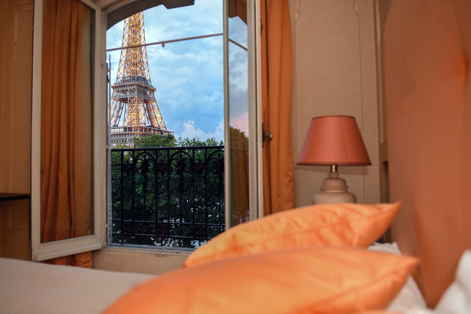 Drift off to sleep in the dreamy bedroom with Eiffel Tower views.