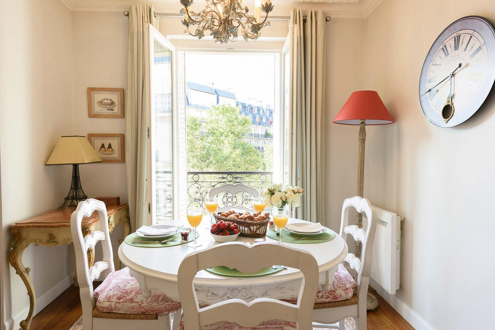 French windows and beautiful views continue in the dining area.