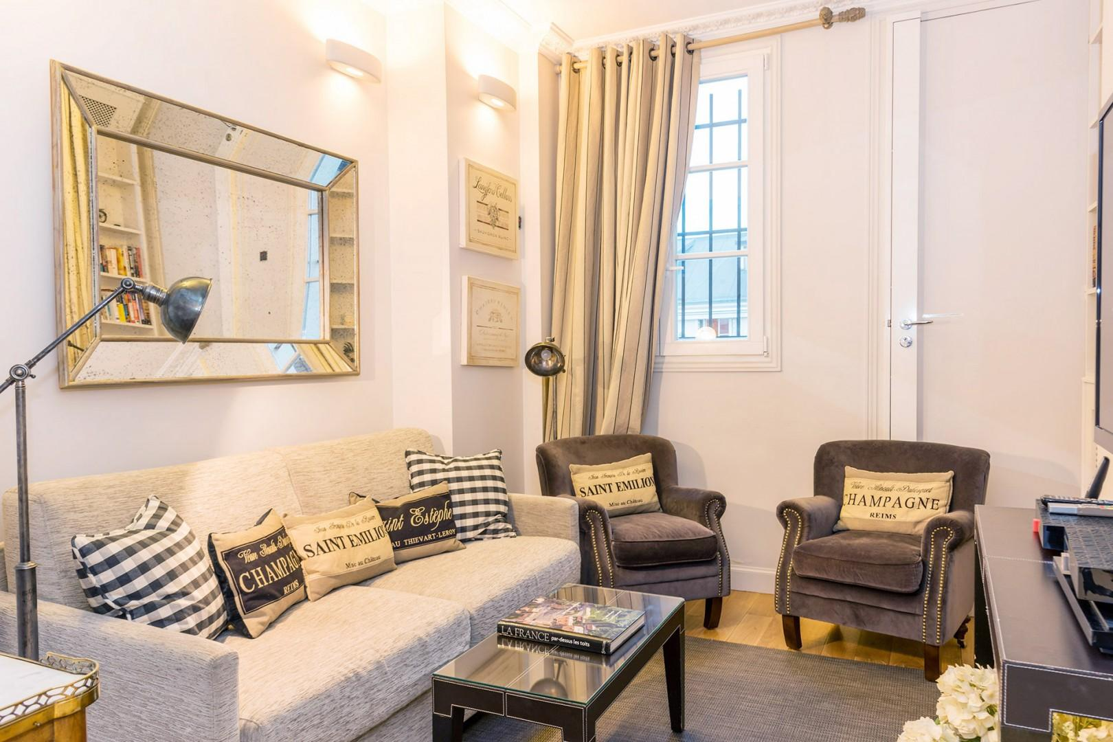The comfortable sitting room offers plenty of space to relax.