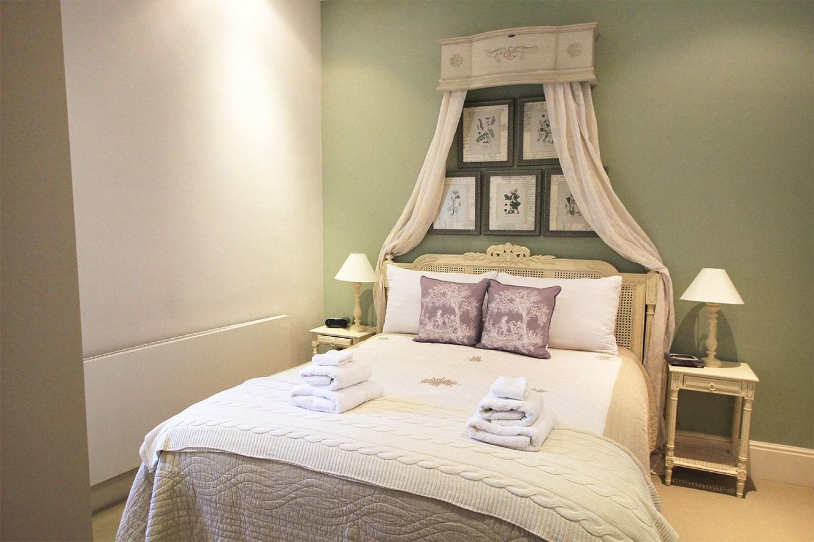 Lovely bed in the first bedroom of London mews