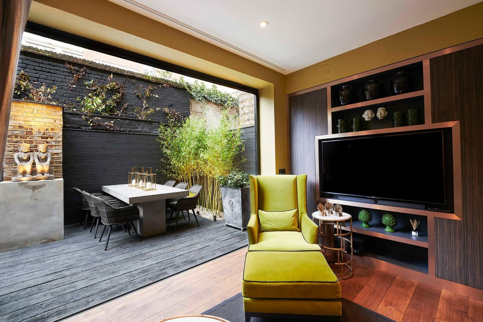 Sumptuous second living room opens onto a private patio