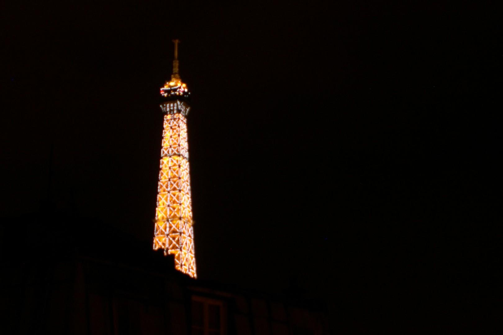 Catch the Eiffel Tower's golden glow at night from your apartment.